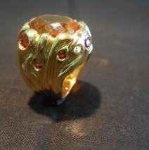 Anello oro giallo, rubeliti e topazio