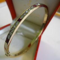 bracciale oro giallo con diamanti e rubini  carrè